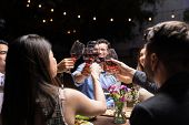 Excited Best Friends Clinking Red Wine Glasses At Backyard Party During Weekend poster