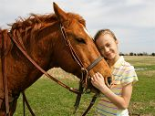 picture of horse riding  - A happy girl on a spring day with her horse on a Texas ranch - JPG
