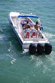 foto of outboard engine  - Motor boat with three outboard engines cruising the intercoastal - JPG