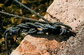 Fishing Colorful Rope Tied To A Hook, Close-up. Cleat And Rope, Yacht Detail. Yachting Concept. Clos poster