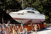 Yacht Motor Boat In The Harbor. White Yacht Motorboat On The Maintenance Structure At The Harbor. Wo poster