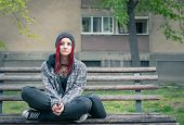 Homeless Girl, Young Beautiful Red Hair Girl Sitting Alone Outdoors On The Wooden Bench On The Stree poster