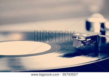 Spinning Vinyl Record. Motion Blur Image.  Vintage Toned. poster