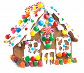 picture of gingerbread house  - Gingerbread house decorated with icing and colorful candies - JPG