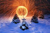 Stunning Lighting Display On Snowy Landscape