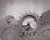 foto of time machine  - Concept of a businessman inside a business mechanism system - JPG