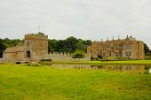 Moat And Manor House In The  Medieval Castle In England In Summer Day poster