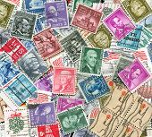 backdrop of old U.S. postage stamps
