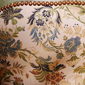 stock photo of brocade  - The back of an antique patterned brocade covered chair - JPG