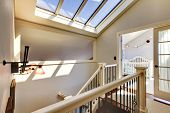 Staircase With Skylight And Baby Room.