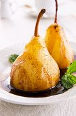 pears poached in amaretto with chocolate sauce