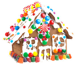 stock photo of gingerbread house  - Gingerbread house decorated with icing and colorful candies - JPG