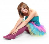 pic of zumba  - Pretty dancer dressed in retro costume sitting on a white background - JPG