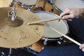 stock photo of drums  - Closeup of hands playing drum set - JPG