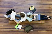 stock photo of sitting a bench  - Top view of male and female university students studying - JPG