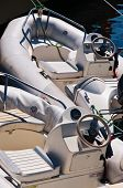image of outboard engine  - Two inflatable motor boat moored on the berth - JPG