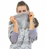Young Woman Hiding In Sweater Neckline poster