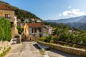 stock photo of conifers  - Small cretan village in Crete island Greece - JPG