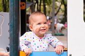 stock photo of debonair  - Positive little baby in playing in the park - JPG