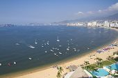 picture of all-inclusive  - huge bay of hotels stretching along the coast in acapulco mexico - JPG