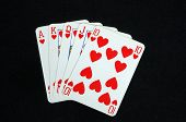 image of flush  - Royal Flush poker hand in the heart suit against a black background - JPG