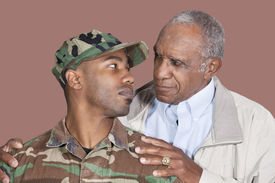 image of united states marine corps  - Father and US Marine Corps soldier looking at each other over brown background - JPG