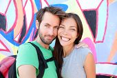 picture of selfie  - Happy couple selfie selfportrait in front of Berlin Wall - JPG