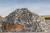 pic of scrap-iron  - Scrap yard with pile of cars crushed into small cubes - JPG