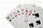 image of skat  - On a puzzle several playing cards are shown - JPG