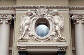 Angel Statues And Oval Window At Baroque Style Facade