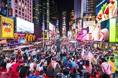 NEW YORK, NEW YORK - APRIL 9, 2013: Times Square crowds at night in Midtown Manhattan. The site is r