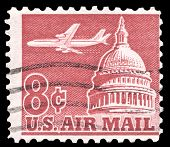 USA-CIRCA 1962: An 8 cent United States Airmail postage stamp shows image of Jetliner Over Capitol B