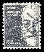 USA-CIRCA 1966: A postage stamp shows image portrait of John Bassett Moore a famous American judge a