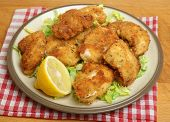 Italian fried chicken fillets with breadcrumbs, parmesan and oregano.