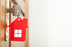 stock photo of keyholes  - Symbol of the house and stick the key in the keyhole  - JPG