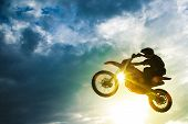 stock photo of dirt-bike  - Motocross Bike Jump - JPG
