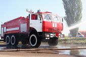 picture of fire truck  - The fire truck extinguishes the lit - JPG