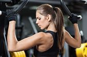 image of lifting weight  - Attractive young woman working out on weight - JPG