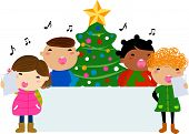 stock photo of christmas song  - Group of children singing around a Christmas tree and banner - JPG