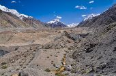 pic of shan  - Lower parts of scenic Engilchek glacier with picturesque Tian Shan mountain range in Kyrgyzstan - JPG