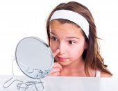 stock photo of pimples  - Teen girl searching for pimples looking in the mirror - JPG