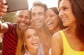 picture of sun flare  - Group Of Friends On Holiday Taking Selfie With Mobile Phone - JPG