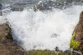picture of off-shore  - A marine wave breaks against off - JPG