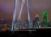 image of bridge  - Cross Section of a downtown Dallas bridge at night with light streaks from the passing cars - JPG