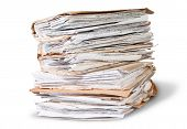 stock photo of messy  - Old Files Stacking Up In A Messy Order Rotated Isolated On White Background - JPG