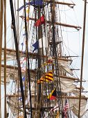 foto of yardarm  - View of the rigging of historic tall ships lined up one after another - JPG