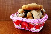 picture of tamarind  - tamarinds are in the pink basket on wooden background - JPG
