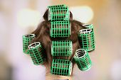 image of hair curlers  - Long female hair during hair dressing with curler - JPG