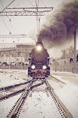picture of train-wheel  - Retro steam train departs from the railway station at sunset - JPG