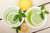image of infusion  - fresh and healthy mint infusion tea tisane with lemon  - JPG